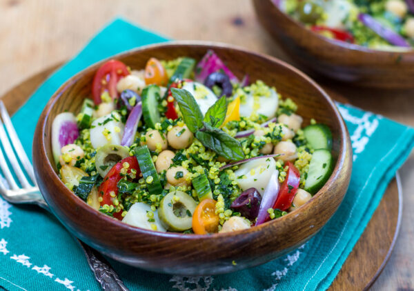 My version of they healthy Middle Eastern Salad spiked with a melange of Vegetables is tossed in a Zesty Lemony- Scallion Dressing.