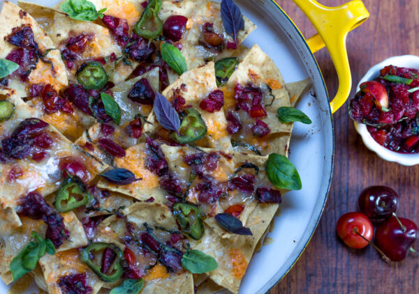 Layer the cherry salsa with the tortilla chips and cheeses and bake