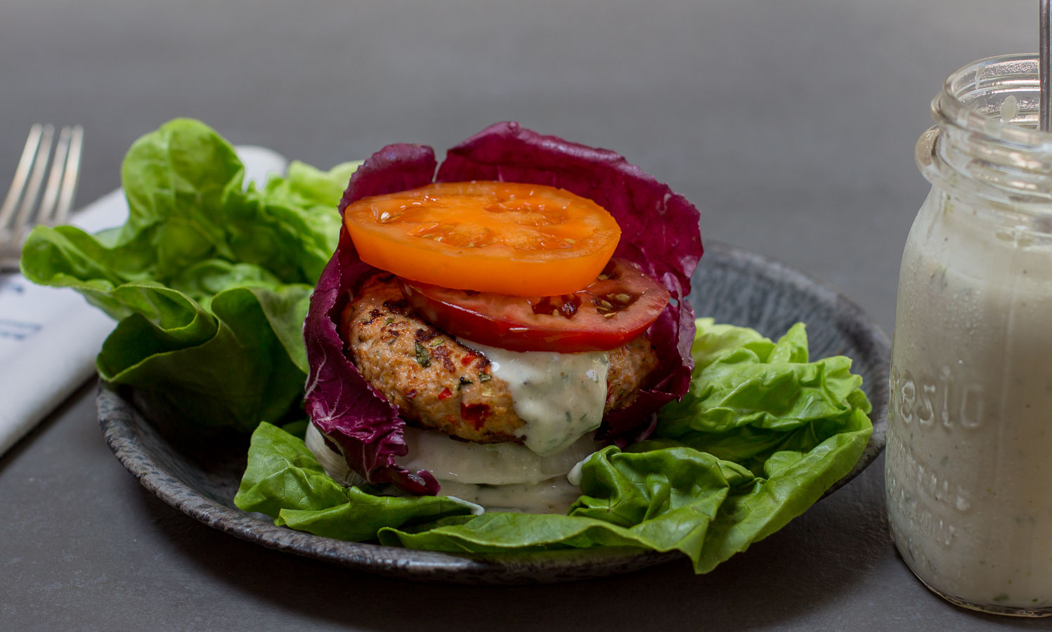 The Ultimate Grilled Burger Wrapped in Lettuces with Onion and Heirloom Tomatoes ~ Homemade Ranch Dressing.