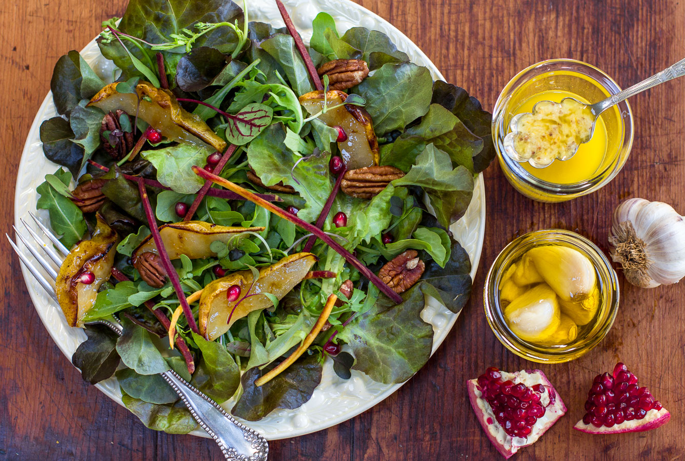 A light Fall Salad with crunchy textures dressed with a Zesty-Lemony Vinaigrette with Confit Garlic