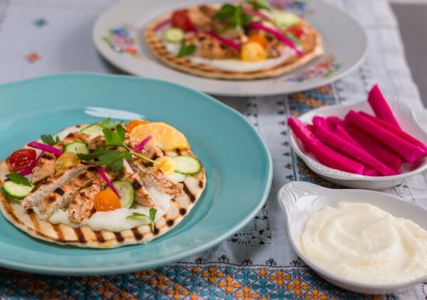 Yogurt Marinated Chicken, Lebanese-Style Garlic Sauce, Harissa Sauce and Pickled Turnips come together for the ultimate Middle Eastern Feast at home