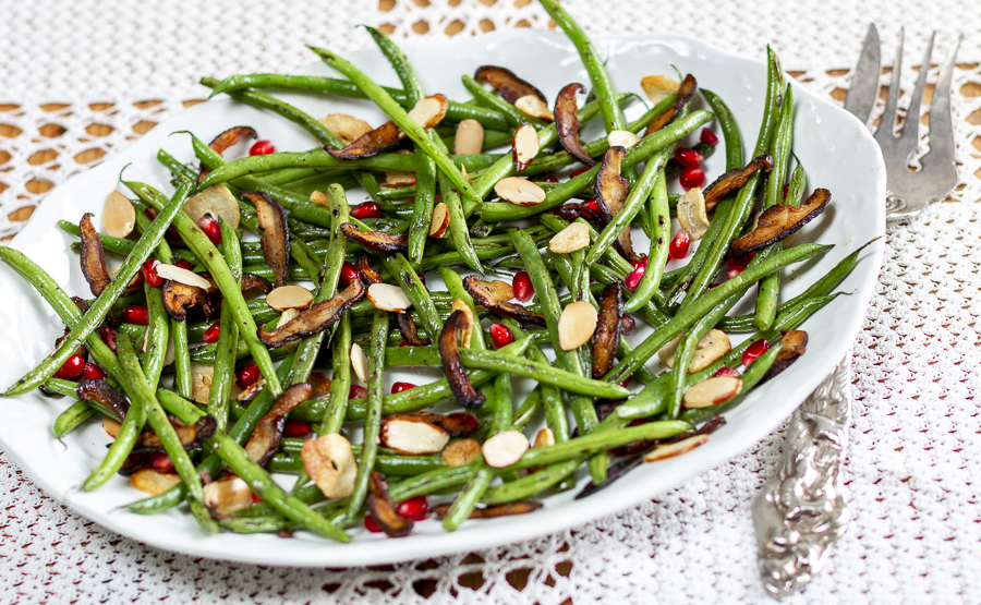 """Haricot Vert with Garlic, Almonds, Pomegranate Seeds and Shiitake """"Bacon"""" with Za'atar Seasoning on a vintage platter"""