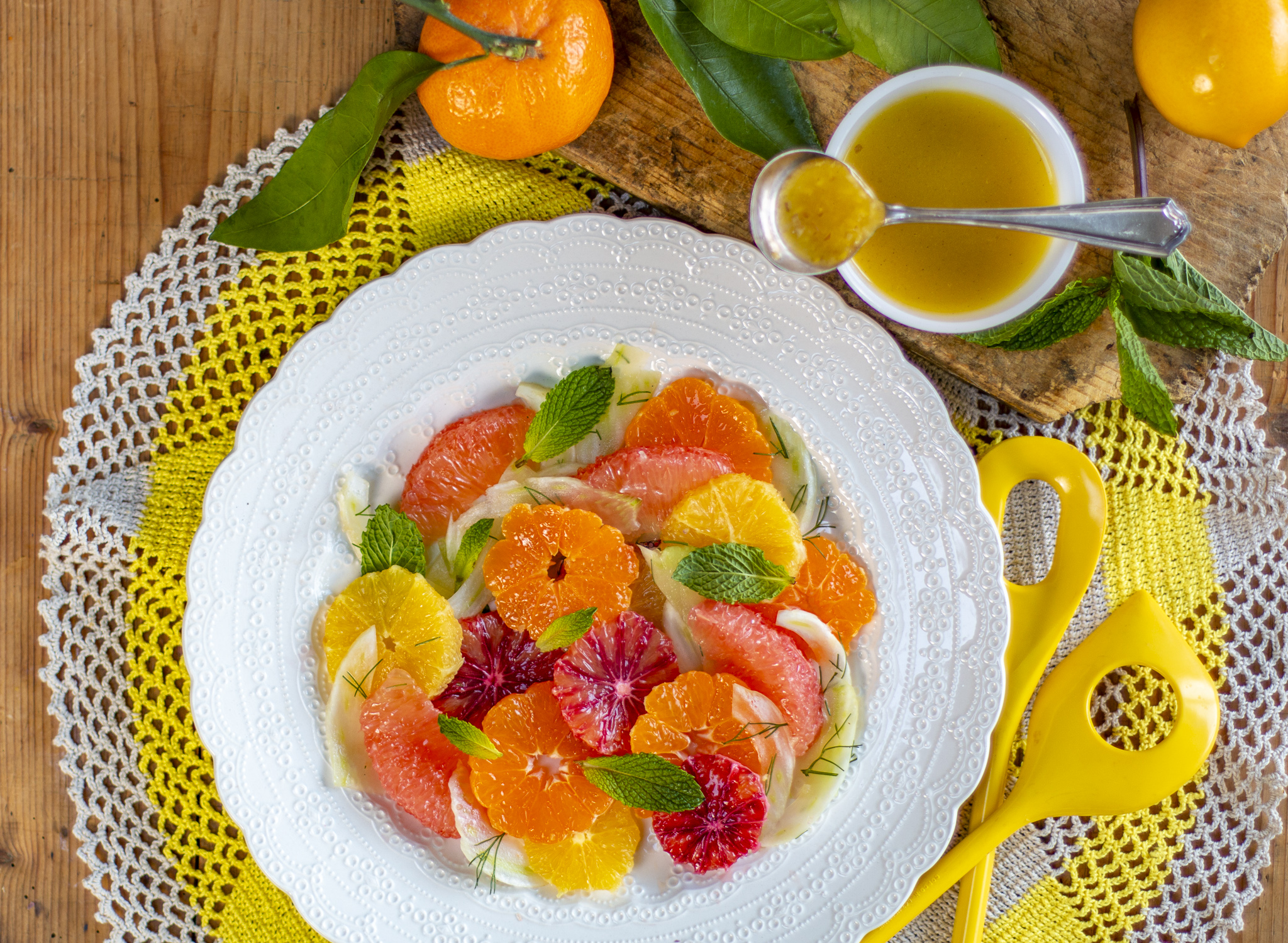 Multi citrus salad layered with shaved fennel and mint