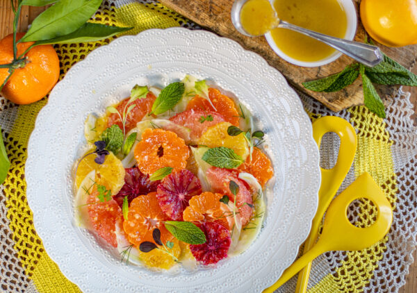 Colorful Winter Citrus is layered with thinly sliced fennel, micro greens and fresh mint