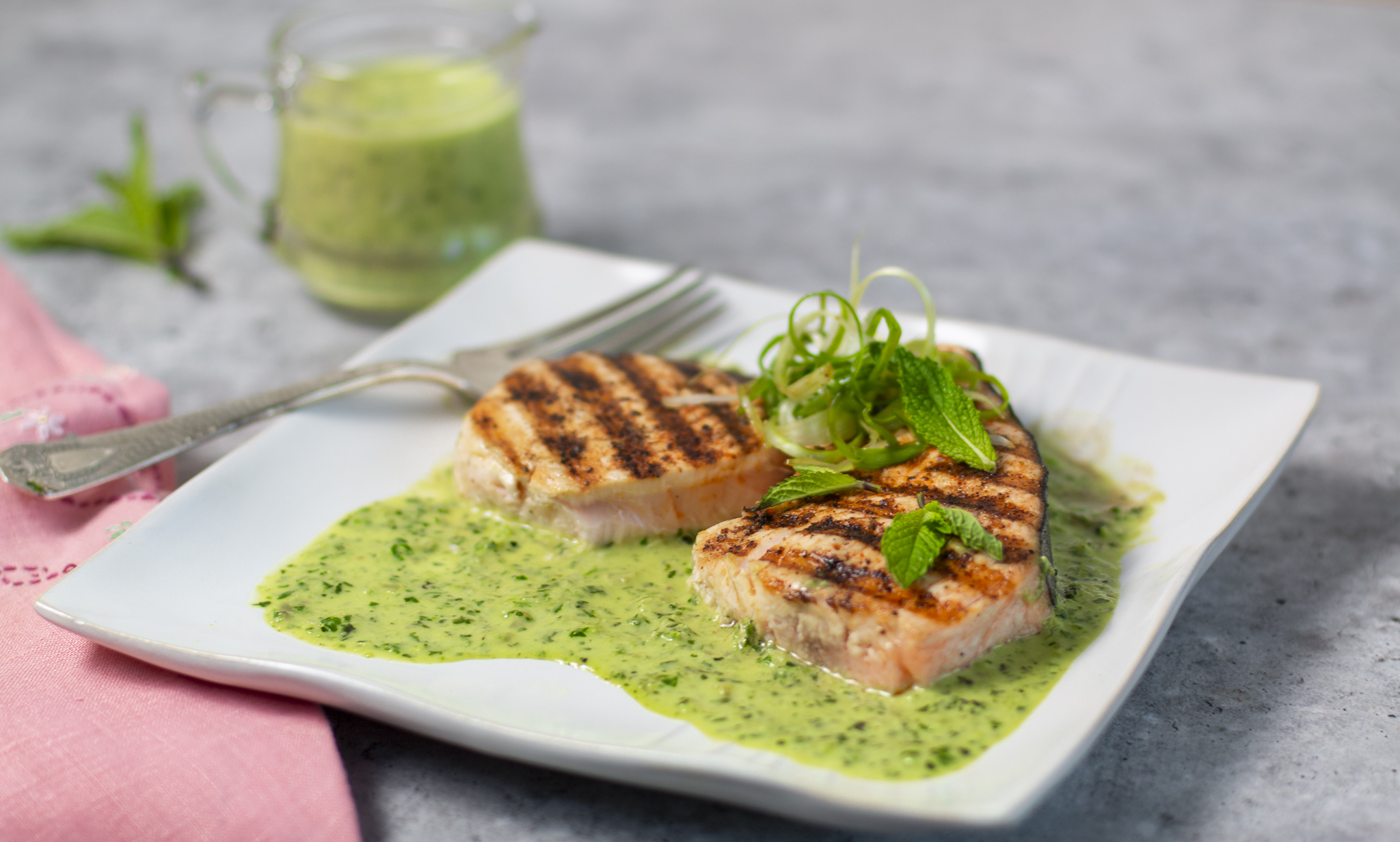 Grilled Pumpkin Swordfish with Green Masala Sauce on a square plate