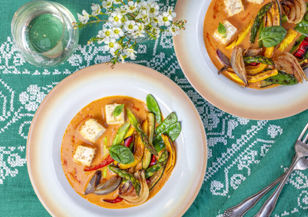 Red Coconut Curry with Sesame Tofu and Roasted Vegetables in a vintage bowl on vintage aqua linens