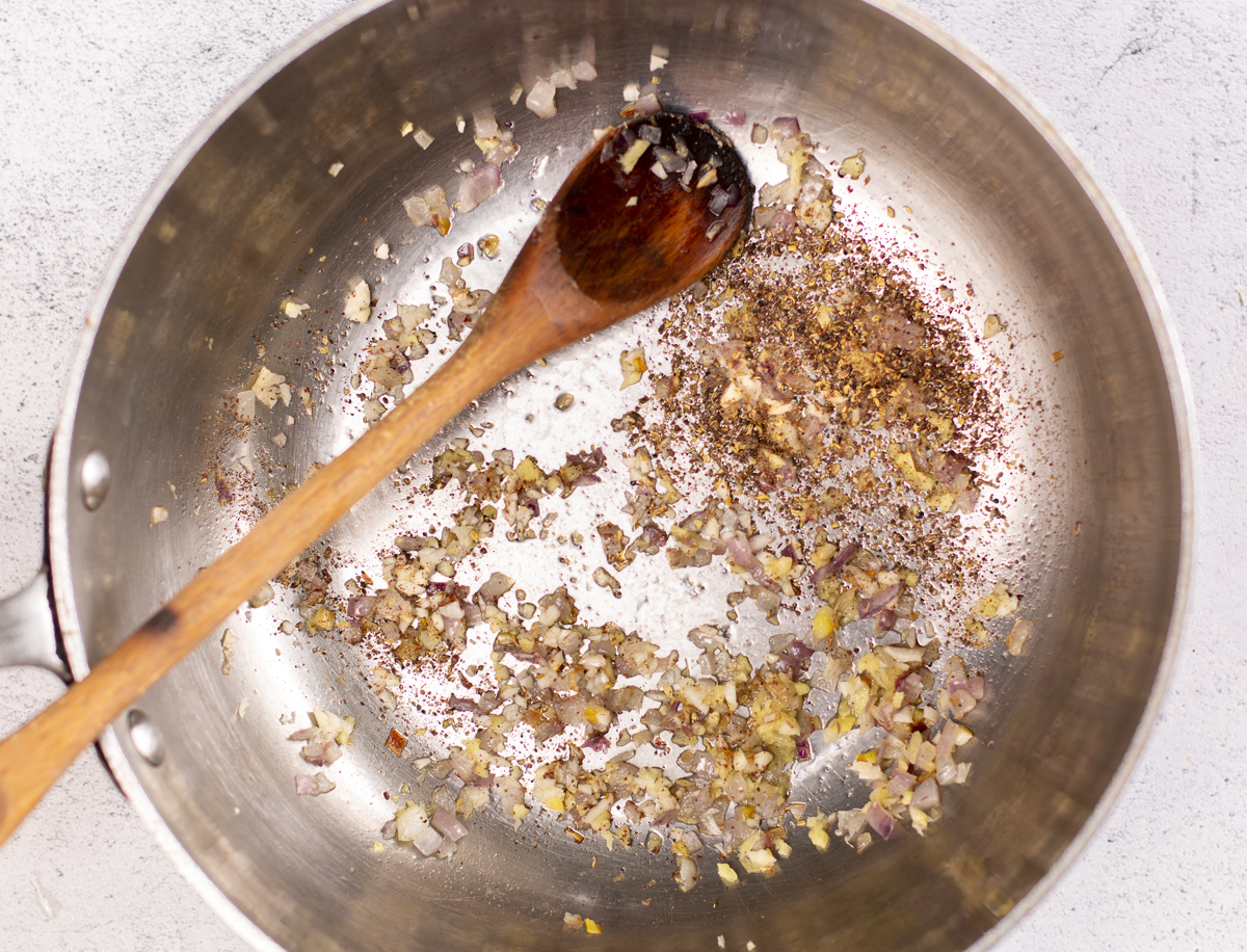 The base for the sauce in a skillet - sautéing shallots, garlic, ginger and Sichuan peppercorns