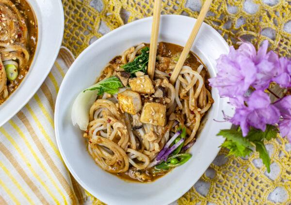 Vegan Dan Dan Noodles with Tofu & Mushrooms in a white modern bowl