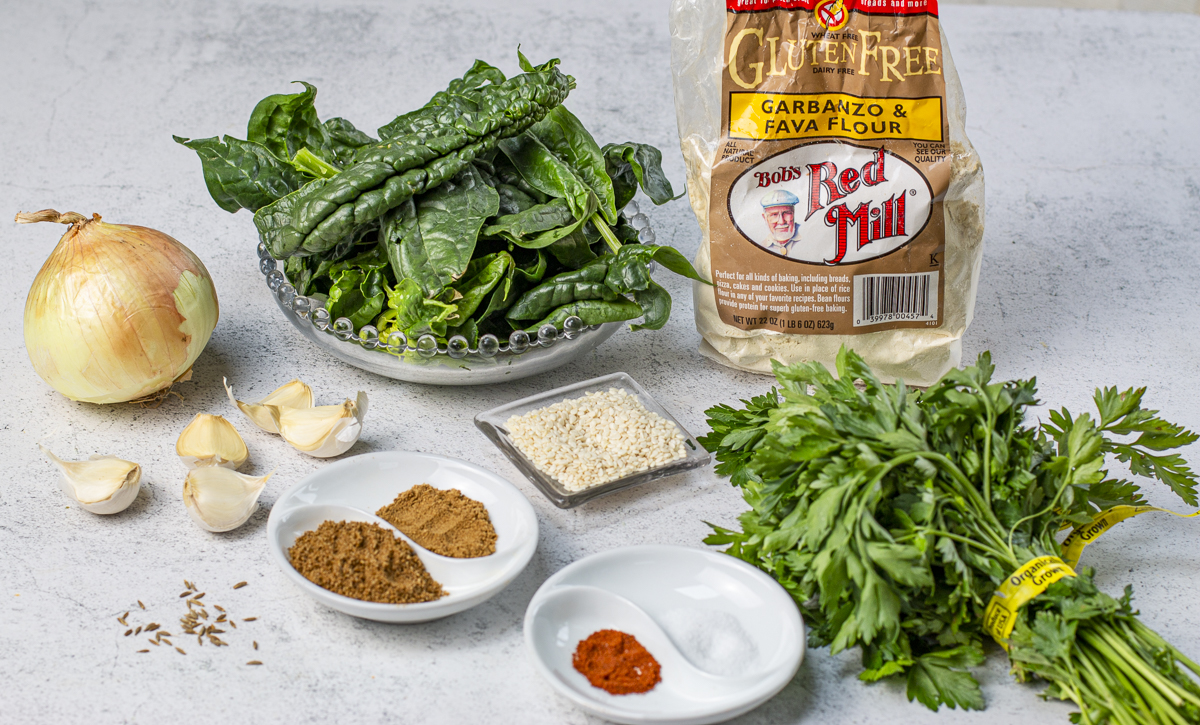 Ingredients other than chickpeas for the falafel on a board