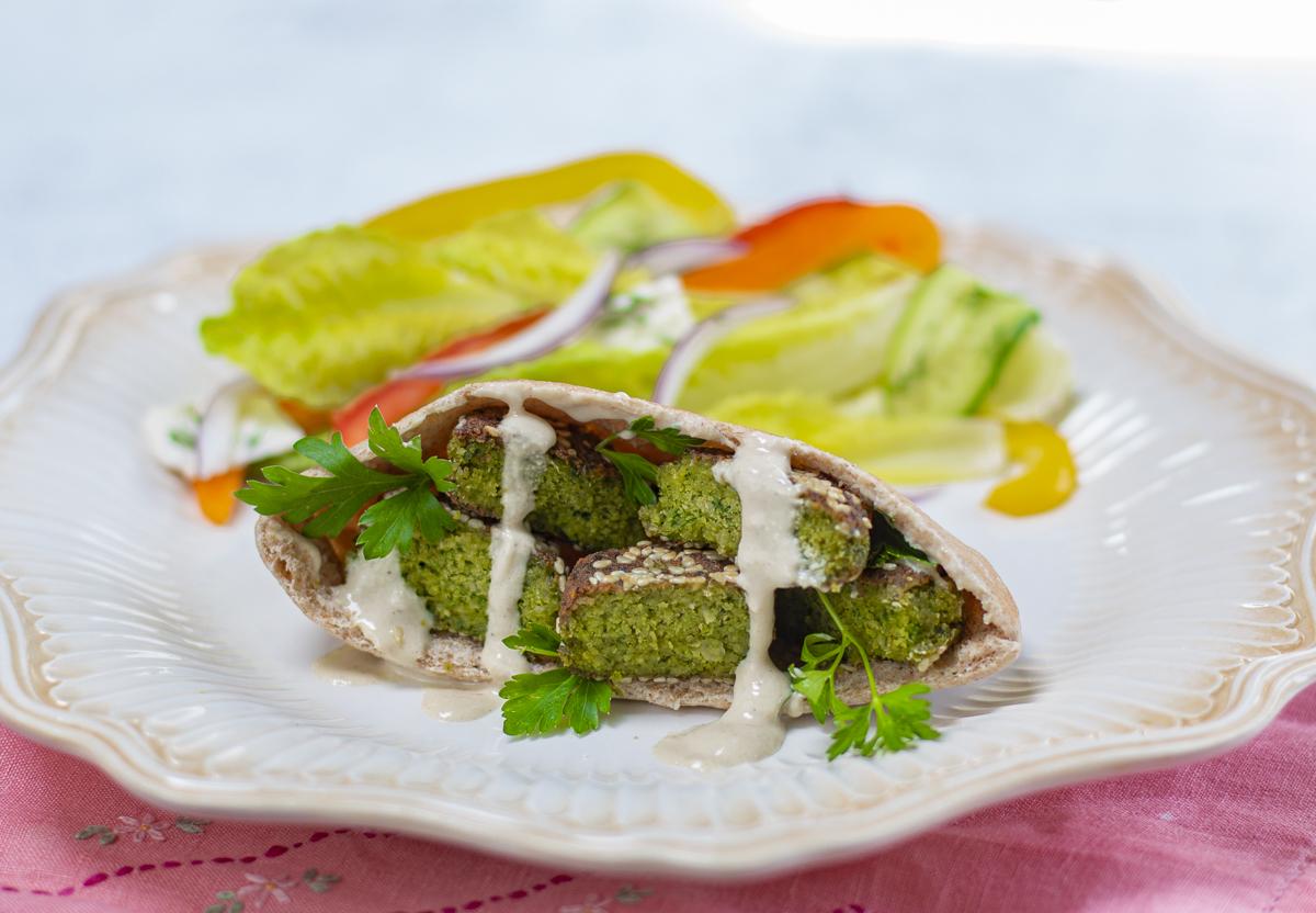 Sesame Coated Falafel in Pita Bread with Tahini Sauce