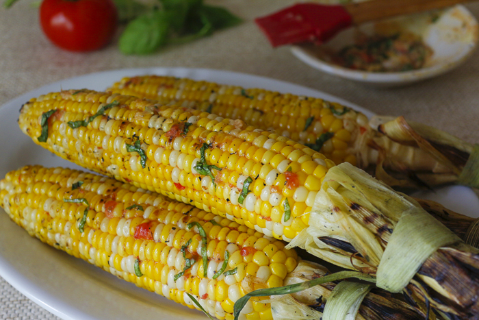 Grilled Corn in the Husk with Tomato-Basil Butter