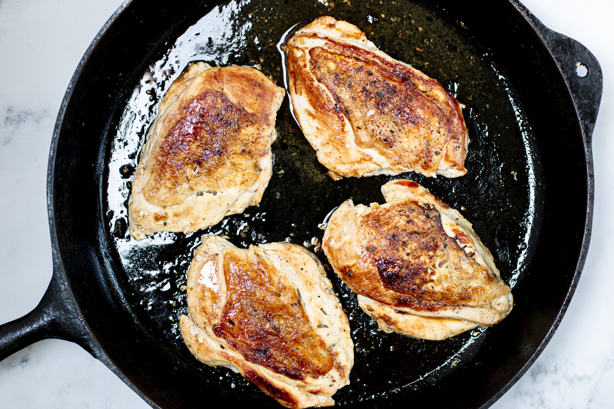 Turn over the chicken breasts, turn down heat and cook a few minutes until cooked through and tender