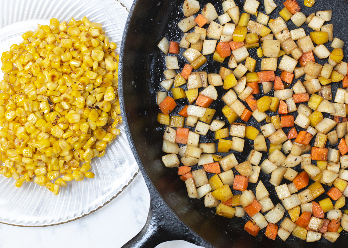 """Cook corn first in the cast iron skillet until golden and """"pops"""" than add remaining vegetables and cook until tender-crisp"""