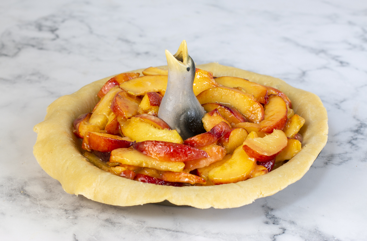 Peach pie with pie bird