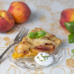 One piece of Peach Pie with whipped coconut cream with basil syrup