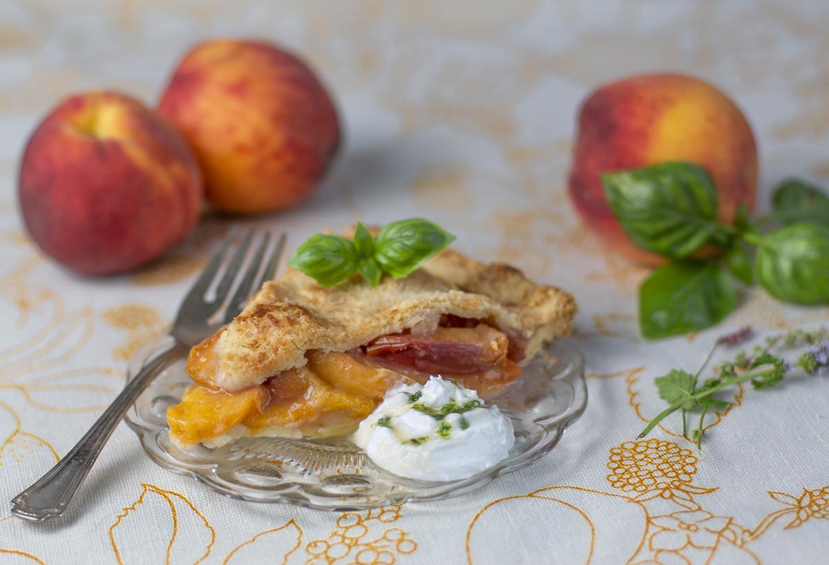 Peach Pie slice with coconut cream & basil syrup