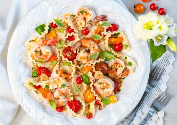 Burst Heirloom Tomatoes Over Pasta with Shrimp in vintage bowl