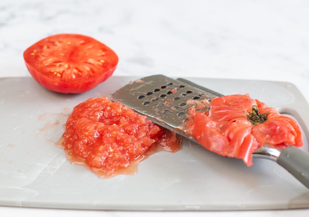 Grating tomatoes for Tomato Vinaigrette