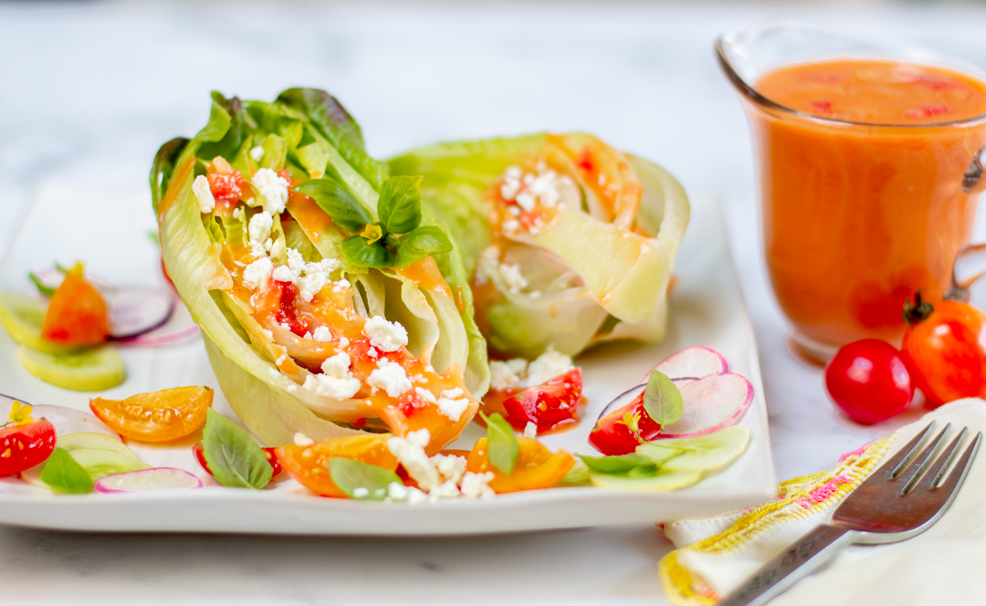 Top the lettuce hearts with Tomato Vinaigrette and sprinkle with feta cheese