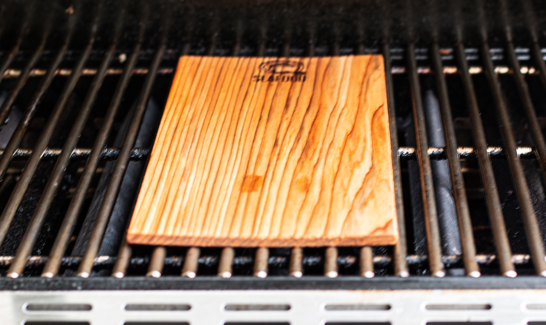 Place soaked cedar plank on grill, close and turn over in a few minutes when it has blackened a bit