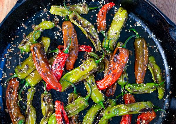 Blistered Sesame Shishito Peppers in cast iron skillet