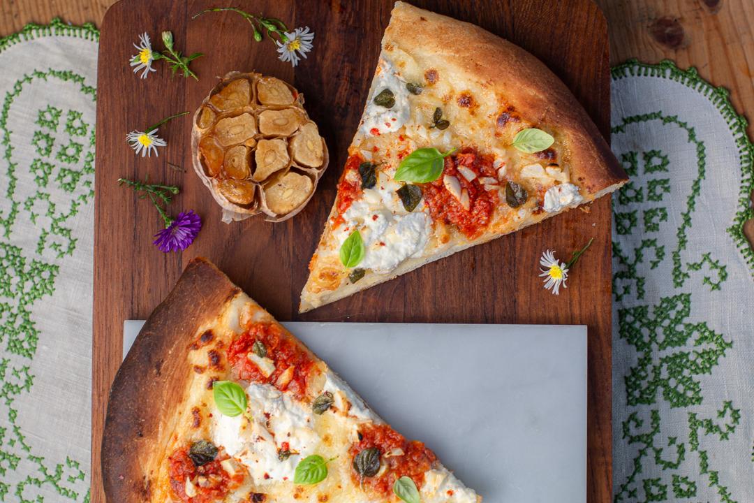 Garlic Pizza with head of roasted garlic