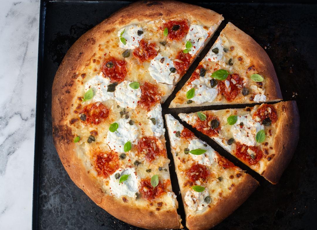Garlic Pizza with Dollops of Ricotta Cheese, Marinara Sauce, Basil - and lots of Garlic!