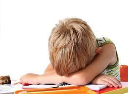 child with head down on desk