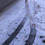 Tire Tracks in Snow.