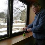 Man inspects window.
