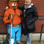 Smokey Bear Cutout with a woman standing beside.