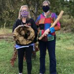 Two women with drum and rain stick