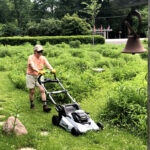 woman with EGO lawnmower