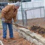 Man turning soil