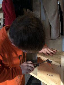 Boy tightens a screw