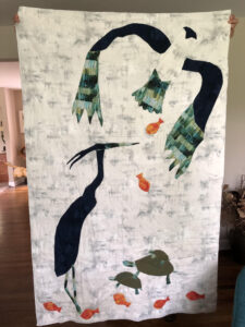 Quilt of birds and fish