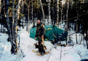 Man camping in winter