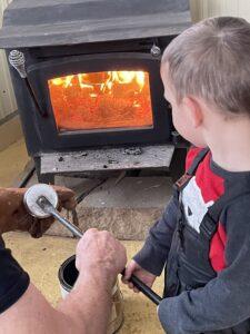 Boy looks at woodstove