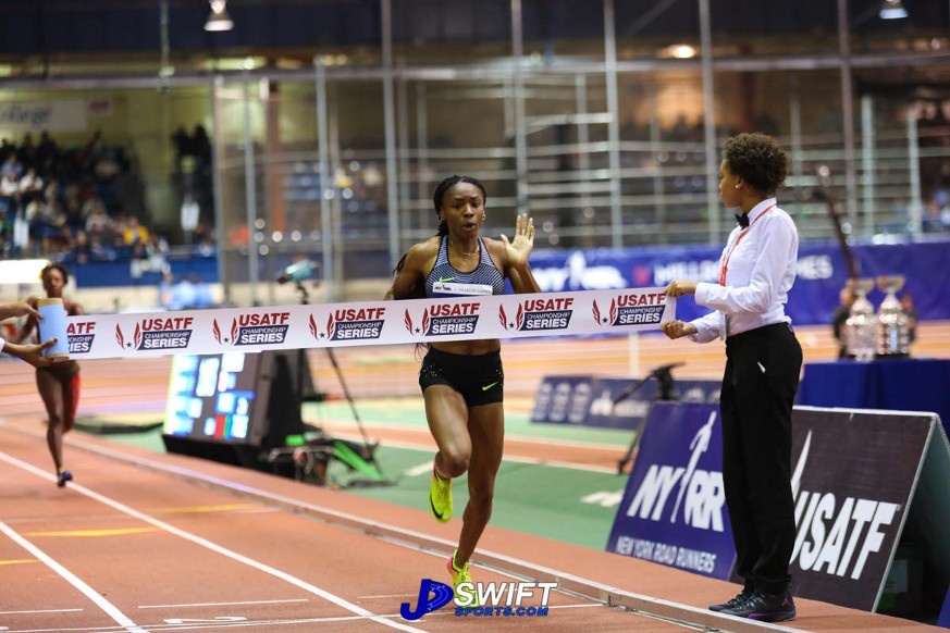 Courtney Okolo crossing the finish line in the 500m.