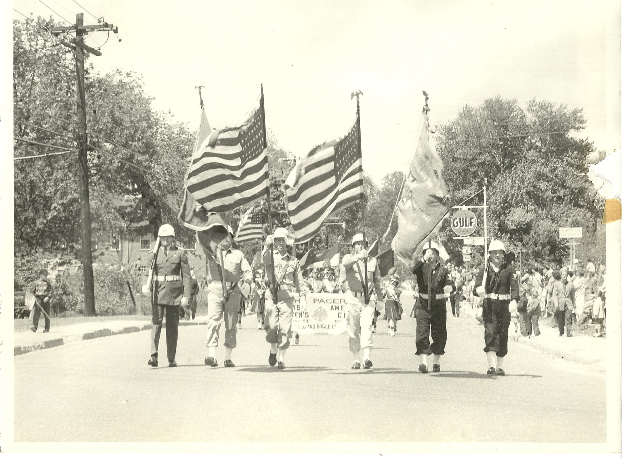 Black & white photo of past Brewster parade. Date unknown.