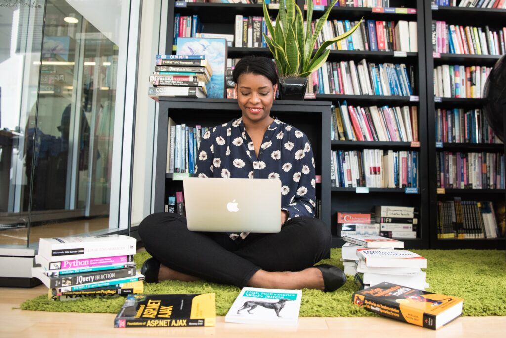 black-woman-laptop-books-taking-courses-chicdivageek