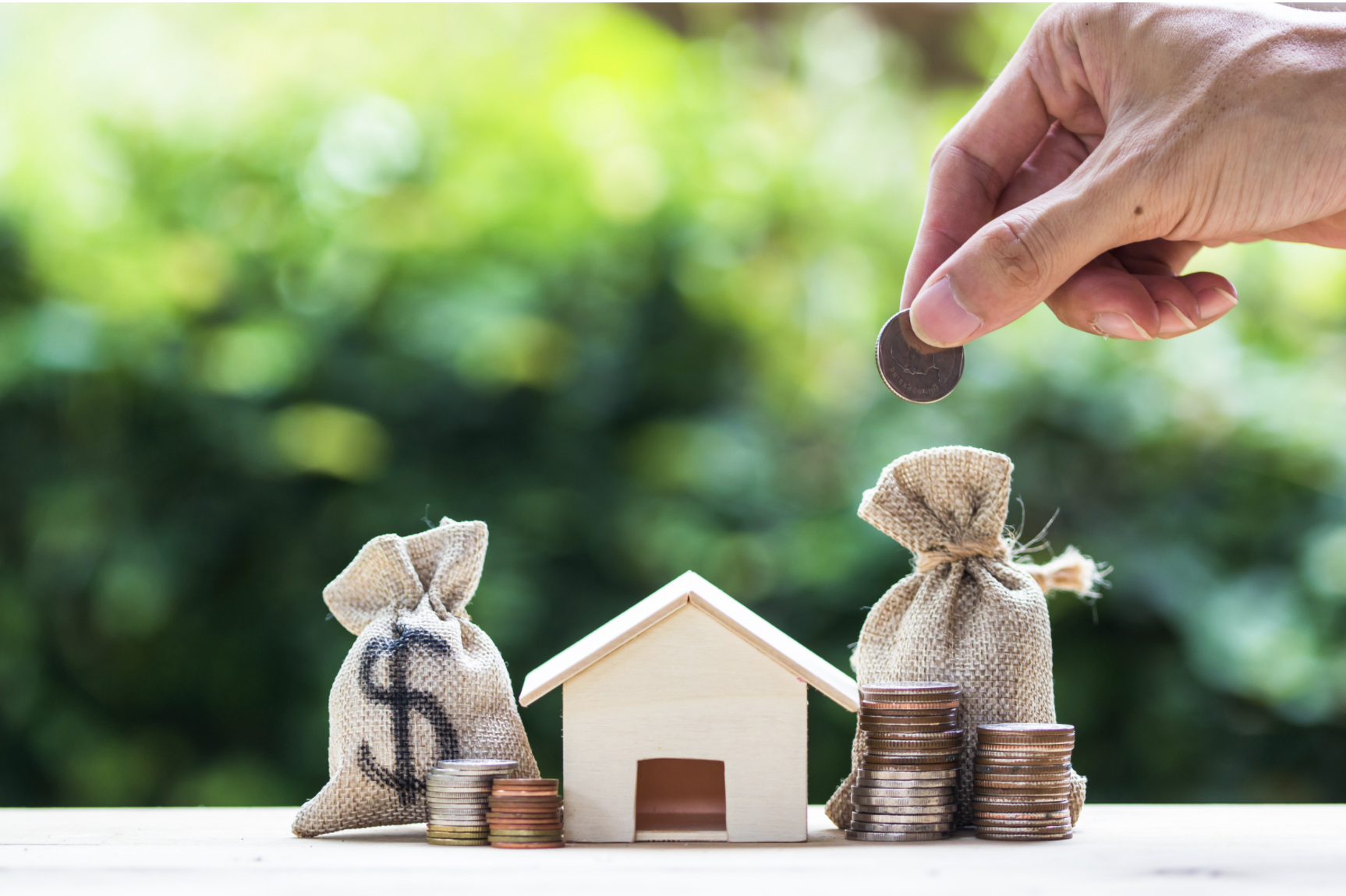 Small house with money around it representing hard money investing