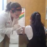 Megan injecting a patient