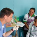 Dr. Frank Harry volunteering in a town of Antigua Guatemala.