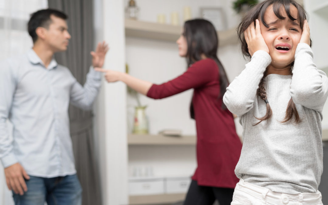 Couple arguing in front of a child Tulsa domestic violence lawyer