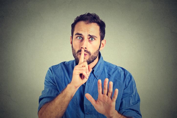 Man giving Shhhh quiet, gesture