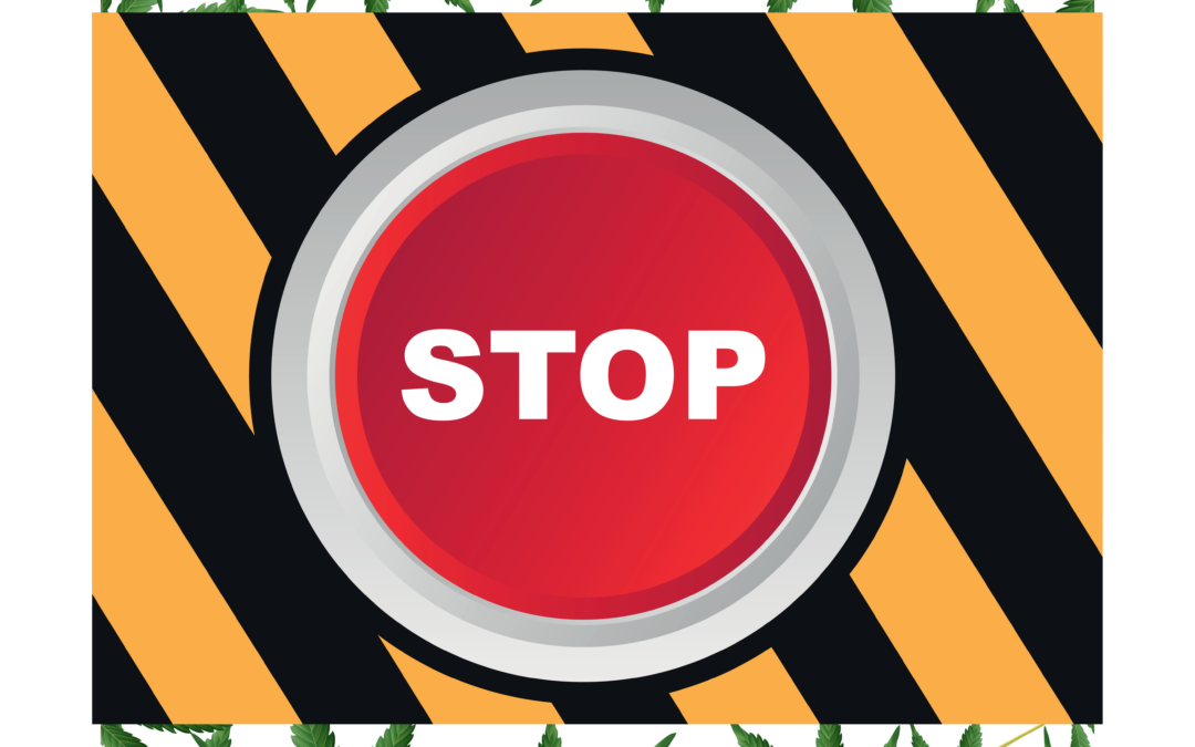 Stop button surrounded by a frame of marijuana leaves
