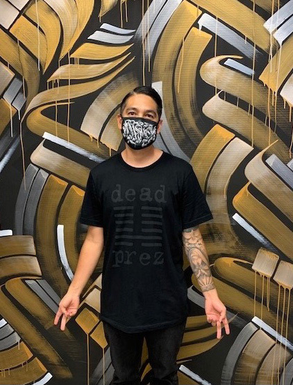 Zak Perez in front of his mural in Newport Beach