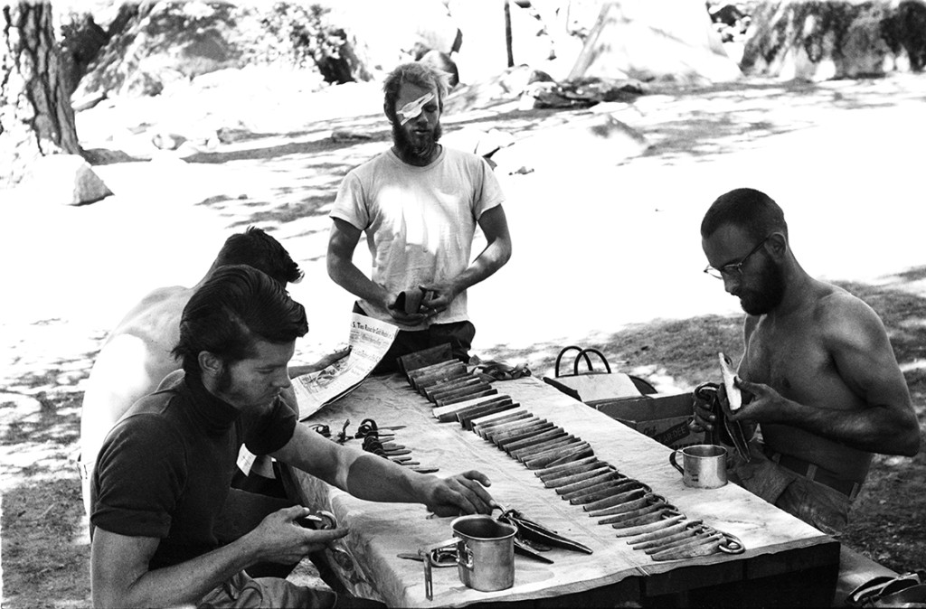 Climbers organizing climbing gear on a table in Yosemite NP, California (Historic Image).