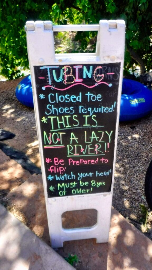 """Tubing Sign: """"Closed toe shoes required. THIS IS NOT A LAZY RIVER. Be prepared to flip, watch your head, must be 8 years old or older."""""""